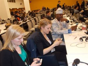 Dr. Shannon Gearhart, US, medical student Vera Gruner, Austria,  and Dr. Emeka Okolo, Nigeria wait to tweet the hoped for good news.