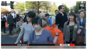Protest outside Japanese Mission in Geneva. (NHK World screenshot)