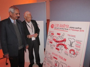 Arun Mitra and Ron McCoy view some of the artwork that captured the content and mood of the CSF over the two days.
