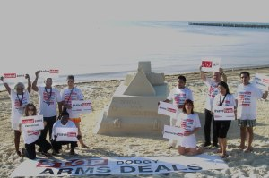 "Dr. Bob Mtonga and colleagues from Control Arms say ""Save Lives"" with sand sculpture at ATT mtg Cancun."