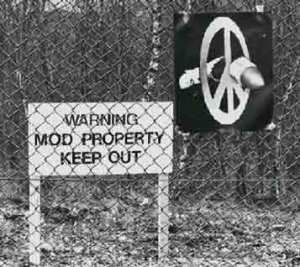 A poster of a broken missile by artist Peter Kennard, taped to the fence of Greenham Common by a protester in 1982. PeterKennard.com