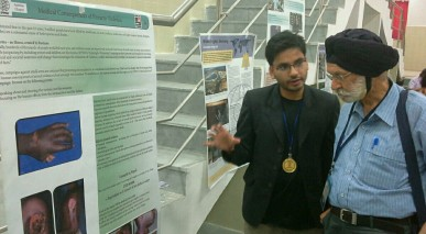 Bimal explains poster exhibition