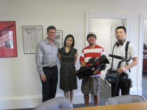 Executive director Michael Christ (left) welcomes NHK TV crew to IPPNW central office.